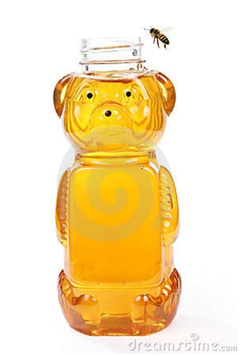honey  bear bottle   flying bee stock photo image