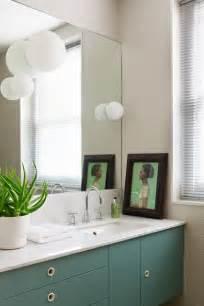 artemide dioscuri lights teal cabinets small bathroom