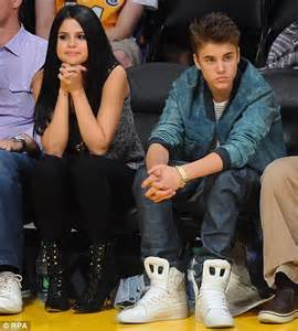 Selena Gomez performs in lacy knee-high boots and Justin ...