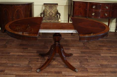 oval mahogany dining table reproduction