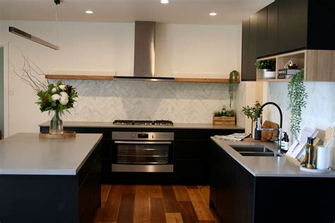 matt black kitchen with timber shelf detailing