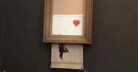 banksy painting girl  balloon  descructs
