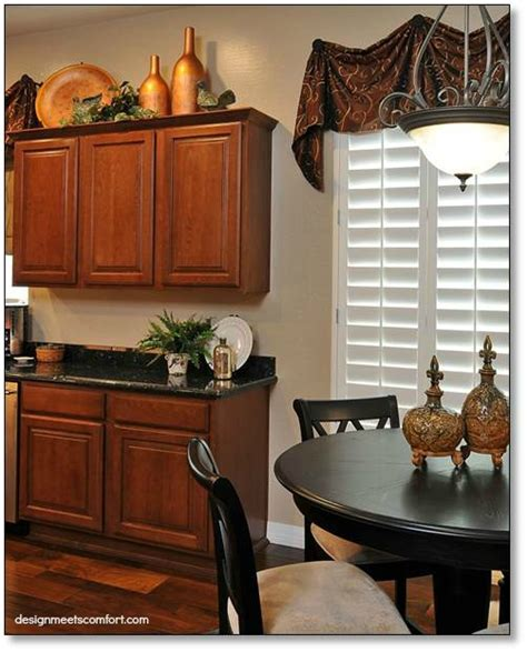 above cabinet decor how do i decorate above my kitchen cabinets la z boy