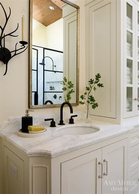 ivory bathroom with rubbed bronze fixtures