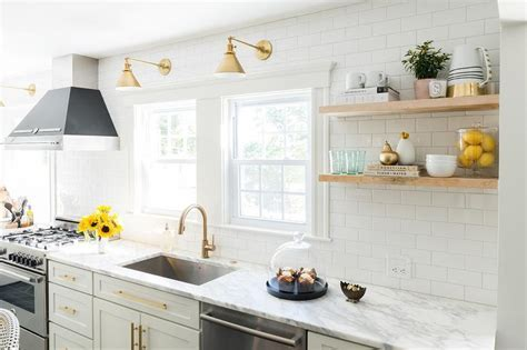 White and Gold Kitchen with Black Range Hood