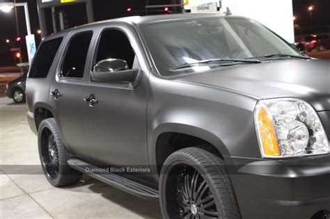 gmc yukon denali wrapped  matte black diamond black