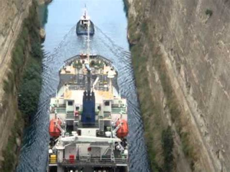 Youtube Tugboat Accidents by A Tugboat Towing A Larger Ship Through The Canal Of