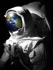 A complete astronaut space suit with a reflection of the ...