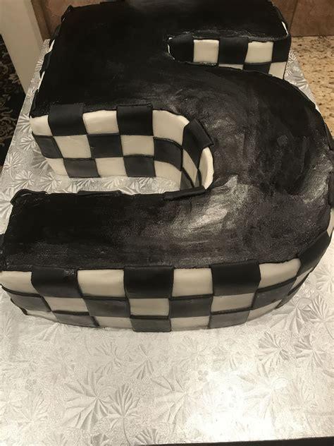 adding black flag checkered design   cake