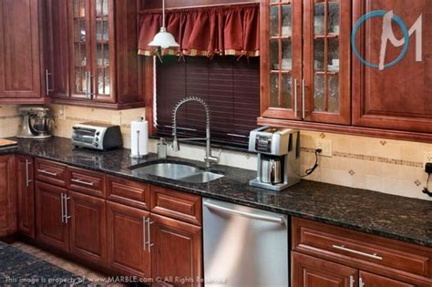 cherry cabinets with gray countertops gray kitchen cherry cabinets quicua com
