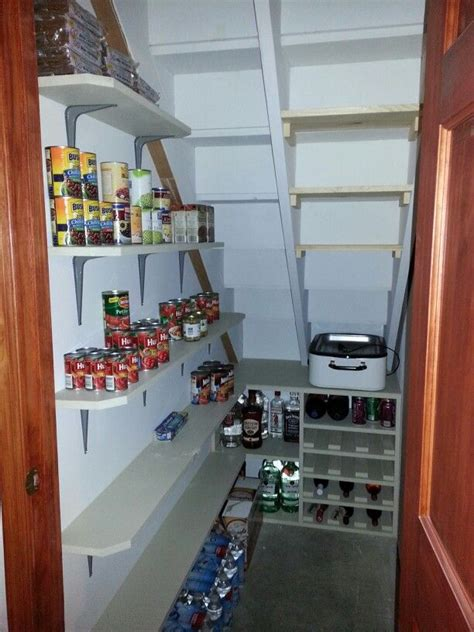 Under stairs pantry ikea shelves, rod and hooks. Awesome, Shelves under stairs and House on Pinterest