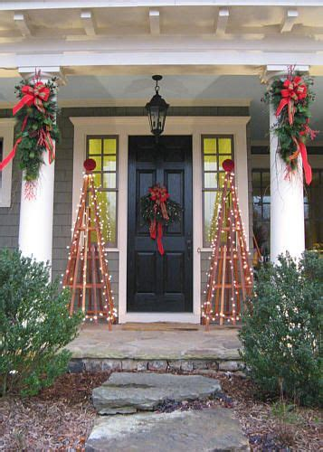 decorating porch column for xmas atlanta ga classic window topiary wreaths porch column boughs and lights