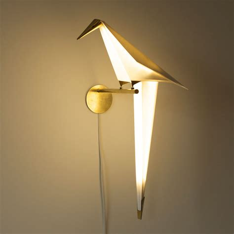wall sconces with origami bird lights by umut yamac colossal