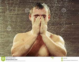 Handsome Young Man Taking A Shower Stock Photo
