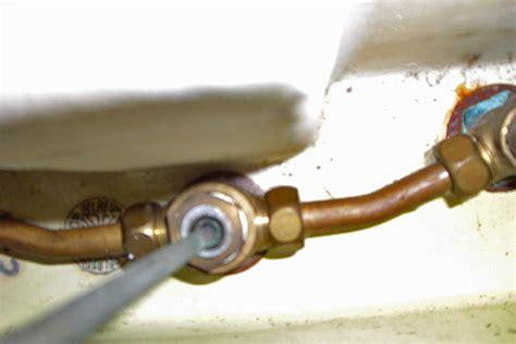 plomberie bricolage remplacer vieux robinet trois trous