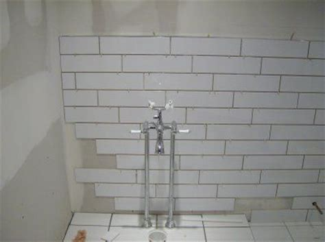 4x16 subway tile patterns 4x16 white subway tiles offset 1 3 2 3 bathroom