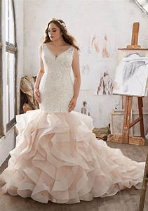 11 designer wedding dresses in extended sizes that we39re for Extended plus size wedding dresses