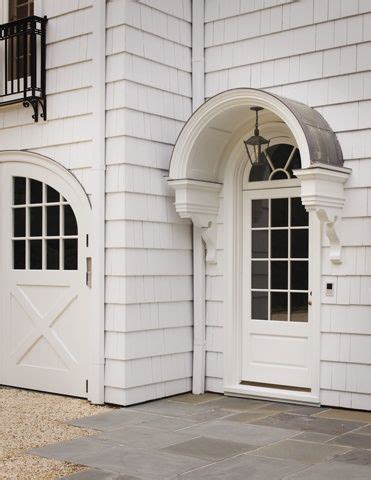 design element metal  canvas awnings arched awning mirror arched carriage doors awning