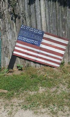 hand  american flag    pallets  brits