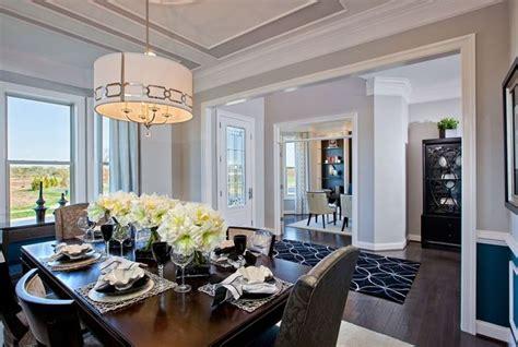 Model Home Decorating: Trim In Ceiling, Shelves In Living