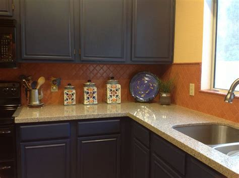 painted  orange builder oak cabinets blue added  terra cotta lantern tile blue sahara
