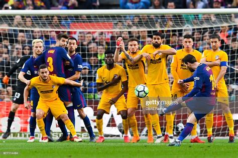 Lionel Messi of FC Barcelona scores the opening goal ...