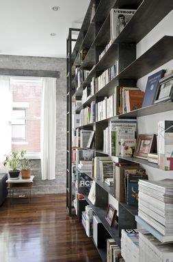 handmade minimal blackened steel bookshelves  rolling