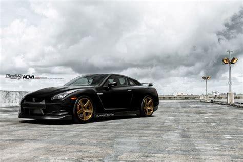 nissan gtr matte black gold black nissan gt r poses with gold adv 1 wheels gtspirit