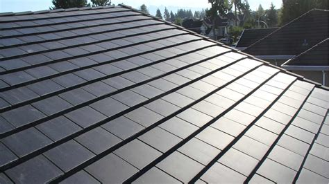 solar roof tiles tesla just unveiled their solar roof and it s a real