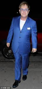 matching shoes for him and elton celebrates turning 66 in bright blue suit at