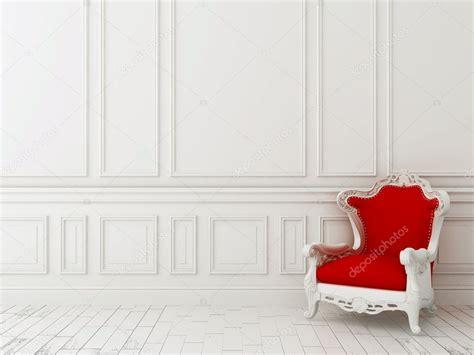 red chair   white wall stock photo  jzhuk