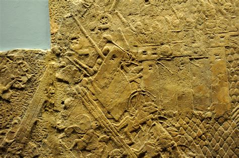 siege bce file assyrian siege engine attacking the city wall of