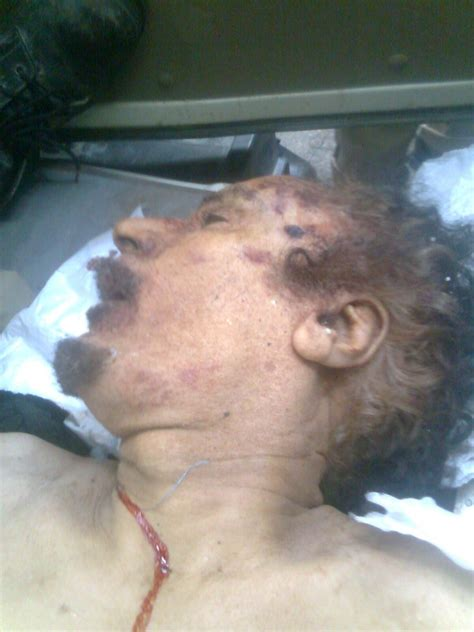 gaddafi dead  video shows bloodied corpse graphic