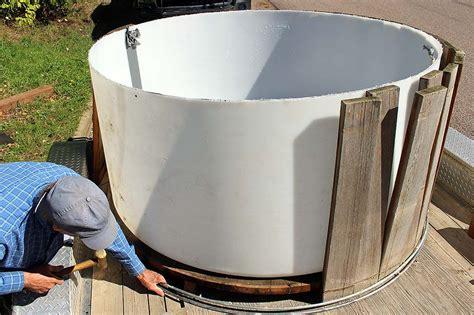 wood fired hot tub renovation  leak liner diy hot