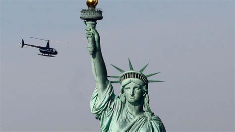 WATCH: Climber on Statue of Liberty base after anti-ICE ...