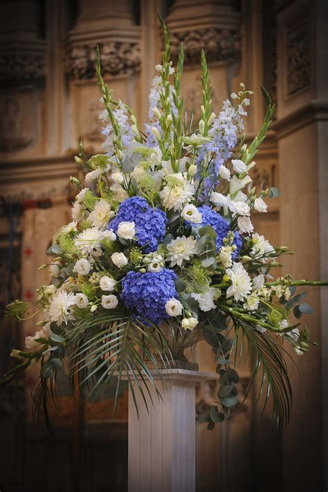 periwinkle blue hydrangea  white church flower display