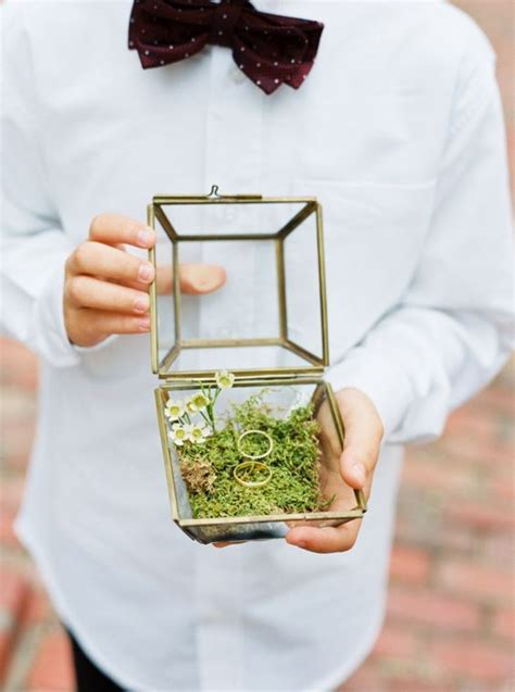 picture of vintage brass glass ring box with moss and flowers inside