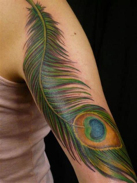 realistic peacock feather tattoo   sleeve