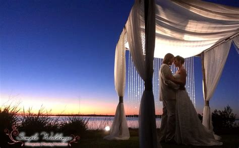 Bride and groom under the lights of our bamboo canopy for