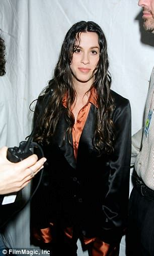 Alanis Morissette looks almost unrecognizable as she ...