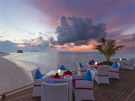 sun aqua vilu reef maldives book   tropical sky