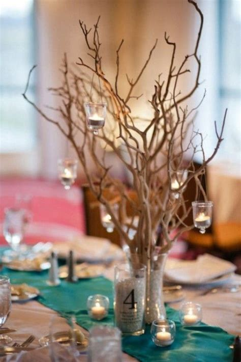 hanging candles  branches rustic beach wedding