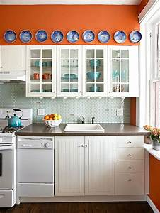 27 cheerful orange kitchen decor ideas digsdigs With kitchen cabinets lowes with orange and blue wall art