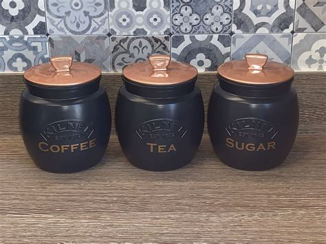 Coffee and tea both have devoted fans, but their appeal extends well beyond providing an energy boost or a playing a key role in a daily ritual. Set Of 3 Tea Coffee Sugar Set Of Canisters Matt Navy Blue