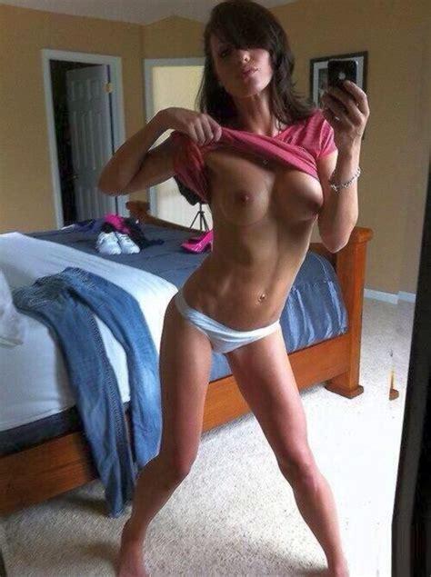 Very Fit Brunette Taking A Dynamic Topless Selfie
