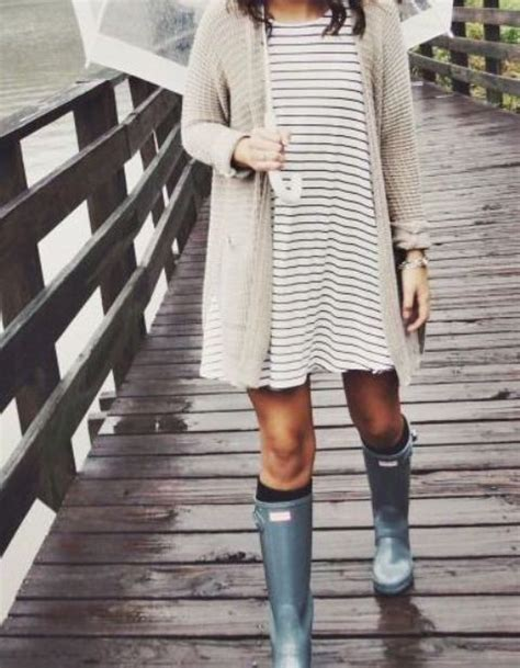 Picture Of a striped dress an ivory cardigan rain boots
