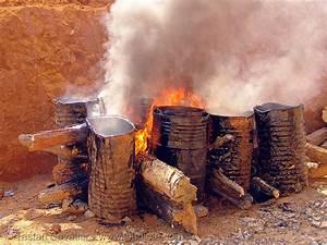 melting asphalt (bitumen) with wood fire, vietnam