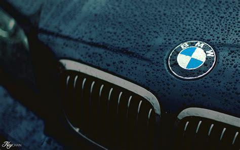 car bmw closeup logo black water drops wet