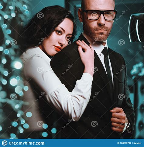 Couple Indoors Sensual Brunette And Handsome Businessman