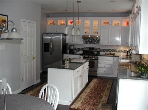 space above kitchen cabinets ideas eliminate the awkward space above cabinets by adding a